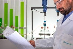 Man in laboratory looking at a document